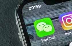 A phone showing the logo for the WeChat app