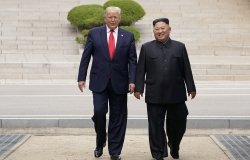 Donald Trump and Kim Jong Un walking together.