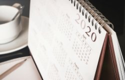 A close up of a desk calendar with the year 2020 visible