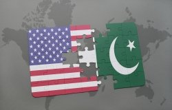 A puzzle that is split in the middle, one side showing the U.S. flag and the other the Pakistan flag