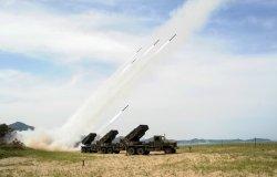 South Korean army units firing rockets.