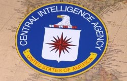 The seal of the CIA sitting on top of a map of North America