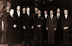 George F. Kennan, American diplomat and historian, posing with others.