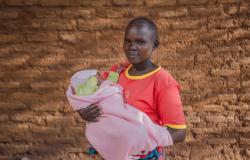 Joyce Makasi holding her baby