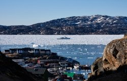Ship, sea ice and cozy town in Greenland