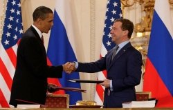 President Barack Obama and Russian President Dmitry Medvedev sign the Prague Treaty in 2010.