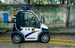 Police micro electric car on the roadway in Chongqing