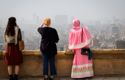 Cairo, Egypt, February 2020 three women overlooking the skyline of cairo