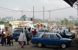 Image - Cabs and minivans wait at a market in Addis Ababa