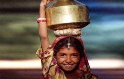 Young girl holding water container in Asia