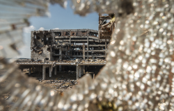Wide angle view of Donetsk airport ruins through broken glass after massive artillery shelling.