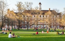 Students mingle on Quad lawn of University of Illinois college campus in Urbana Champaign