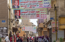 Banners supporting current Egyptian president Abdel-Fattah El-Sisi for a second term for the presidential elections at crowded Al Moez Street, Gamalia district