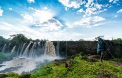 A boy stares at the Blue Nile Waterfalls