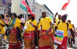 Colourful African campaigners for LGBTI liberation to be recognized with their country's liberation in West Street during Brighton Pride Parade 2018 in Brighton, East Sussex/UK