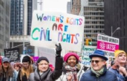 "Group of people walking together – sign reads ""Women's Rights are Civil Rights"" in Midtown Manhattan during the NYC Women's March – New York, NY, USA January 1/19/2019 Women's March."