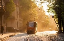 Old orange tram in backlight. Lviv (Lvov), Ukraine