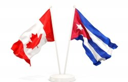 Two waving flags of Canada and cuba isolated on white