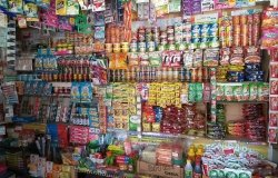 Image of convenience store wall covered in small plastic bags (sachets)