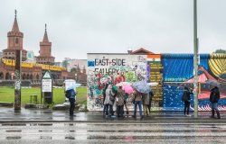 BERLIN, GERMANY - SEPTEMBER 24: The startin of the East Side Gallery with tourists on September 24, 2013 in Berlin.