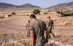 Nagorno-Karabakh, Republic of Artsakh - 08/03/2019 - Three soldiers of the Artsakh Defense Army walking on dirt road in their off time