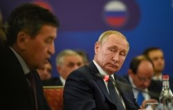 Russian President Vladimir Putin listen to president of Kyrgyzstan Sooronbay Jeenbekov during meeting of the Supreme Eurasian Economic Council in Yerevan, Armenia.