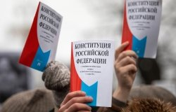 Opposition supporters hold a copy of Russia's constitution during a rally against constitutional reforms proposed by President Vladimir Putin in central Moscow.