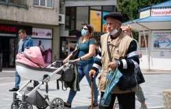 Quarantine in the city of Uzhhorod due to the COVID-19 virus. People in protective masks in the streets of the city