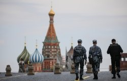 Russian police officers walk across Red Square.