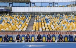 Desna Chernihiv players sit on a bench keeping a safe quarantine distance during the Ukrainian Premiere League game against Shakhtar at NSC Olympiyskyi stadium in Kyiv