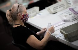 Election poll workers wear masks during the 2020 primary election day in Nevada.