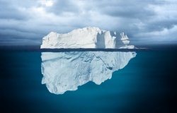 Iceberg Mostly Underwater Floating in Ocean