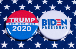 Donald Trump and Joe Biden pin badges, pictured of the USA flag. The two men will be battling eachother in the 2020 US Presidential Election.