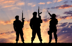 Concept of a terrorist. Silhouette terrorists with rifle at sunset