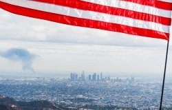 Flag over American city with pollution