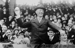 Surrounded by crowds, President Woodrow Wilson throws out the first ball at a baseball game in Washington in this 1916 photo. (AP Photo)